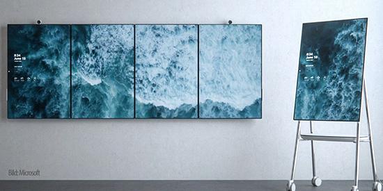 Aufnahme von fünf Bildschirmen in einem Meetingraum