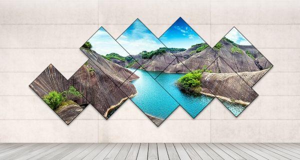 LG Digital Signage Video Wall welche einen See und Felsen anzeigt.